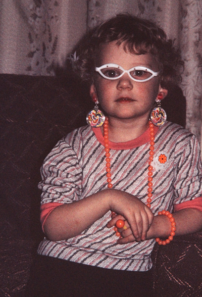 I guess the whole throwing an outfit together started early. Me at age 4 or 5 with borrowed jewelry and glasses.