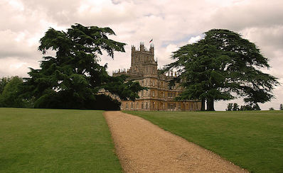 Highclere Castle, the home used for the set of Downton Abbey. –Wikimedia Commons photo by Bas Sijpkes.